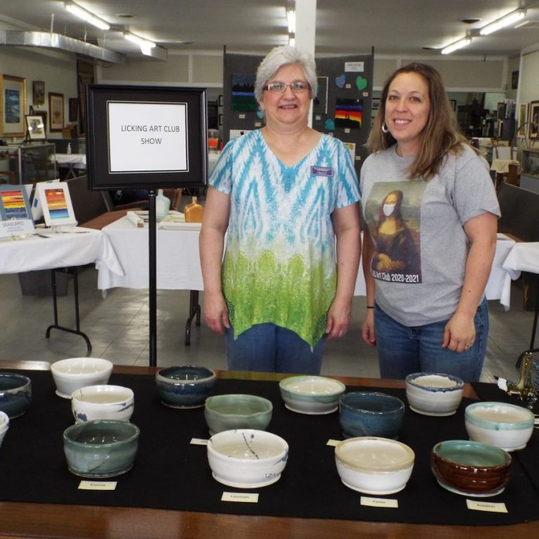 Photo by Christy Porter Art students, area artists, Jackie Duncan, administrator at Texas County Museum of Art & History (left) and Delanie Rinne, Elementary Art teacher (right) proudly showcased the works of art from efforts of the Art Club collective held on Saturday, April 17. The local community, including students, parents, artists and teachers, came to view the many artistic endeavors. The Art Club collective and the Art Show were considered a success. Artwork will remain on display at the museum for a limited time.