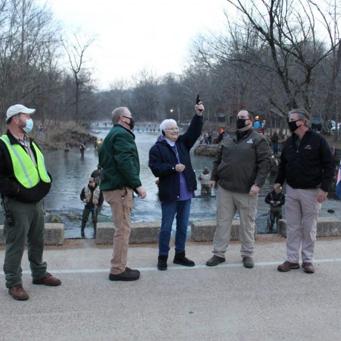 Photo by Shari Harris Wanda (Wisdom) Major fired the opening shot for the opening day of trout season at Montauk State Park on March 1. From left are Park Naturalist Steve Bost, Hatchery Manager Tom Whelan, Major, Asst. Hatchery Manager Kyle Case and Montauk Superintendent Doug Rusk.