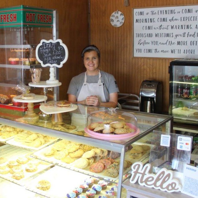 Photo by Shari Harris Kristi Larimore welcomes customers to Basic Biscuits, where choosing which cookie to buy can be a difficult decision – they all look delicious.