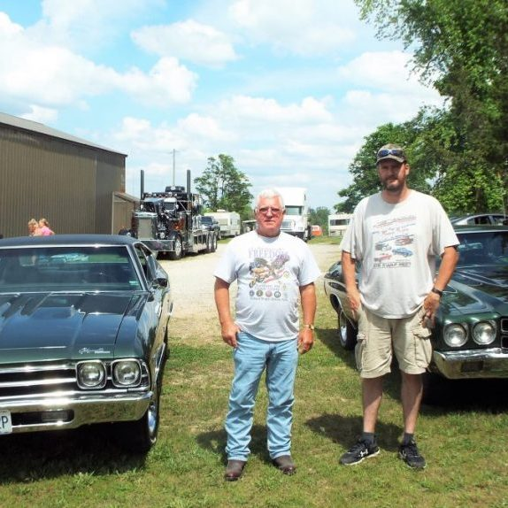 Photo by Christy Porter Dennis King (left) and Doug Hebblthewaite (right), coordinators of the Kingtown Cruise In, stand beside vintage Chevelles, one of which King owns.