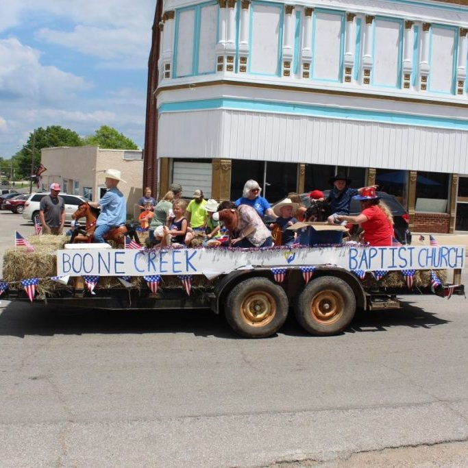 """Photo by Shari Harris The rodeo parade was popular, as children and their families lined Main Street to see the classic cars and truck, horses, floats and more. The candy thrown out in large volumes added to the children's interest. The winners of this year's rodeo parade, themed """"Back in the Saddle Again,"""" were, first place Boone Creek Baptist Church, with one of their three vehicles shown above. Below is second place winner Town & Country Bank. """"Thank you to Jimmy Sherrill and the men and women of the Licking Rural Fire Department, along with the Licking Police Department and all those who participated in the parade,"""" says parade organizer Haley Floyd-Joyner, on behalf of the Licking Chamber of Commerce."""