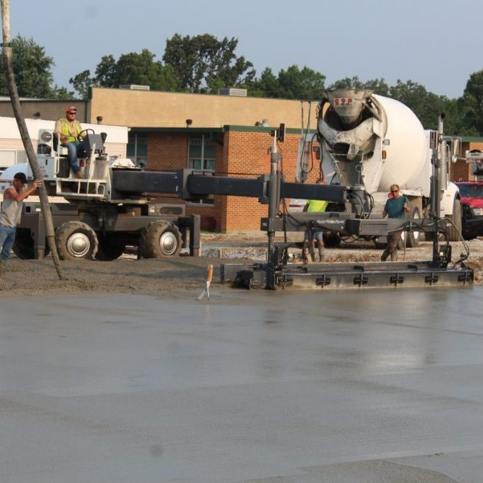 Photo by Shari Harris A queue of cement trucks headed to Licking Elementary School early Tuesday morning, where Gray Construction Company worked to pour the 8,064 sq. ft. slab for the modular building.
