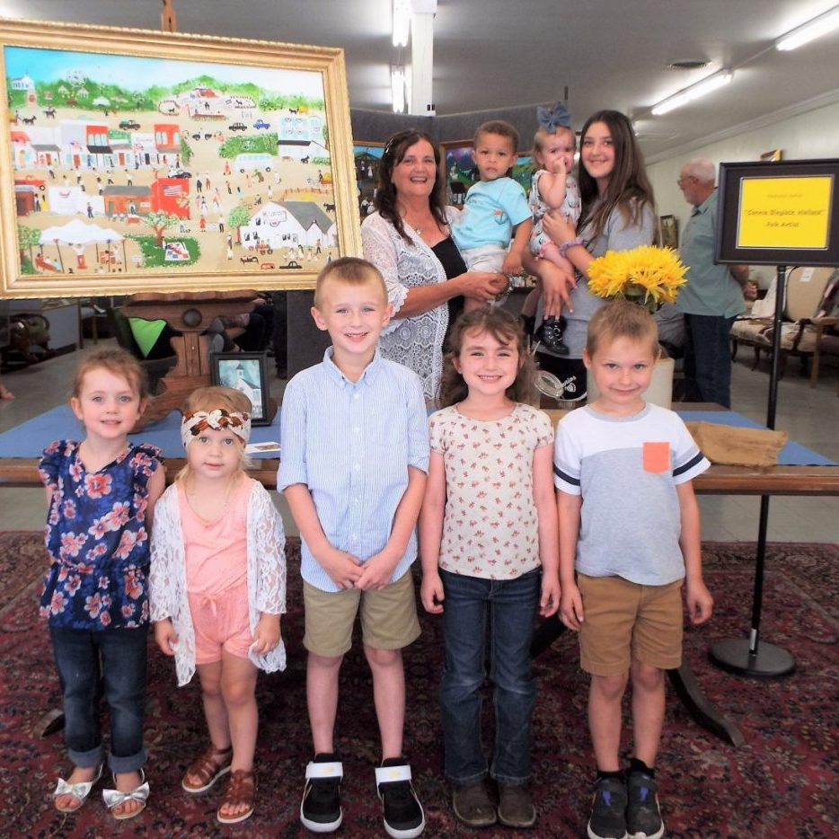 """Photo by Christy Porter Folk Artist Connie Blaylock Wallace, surrounded by grandchildren and a great-grandchild, enjoyed her """"Folksy Paintings"""" Art Reception, as did a host of family and attendees."""